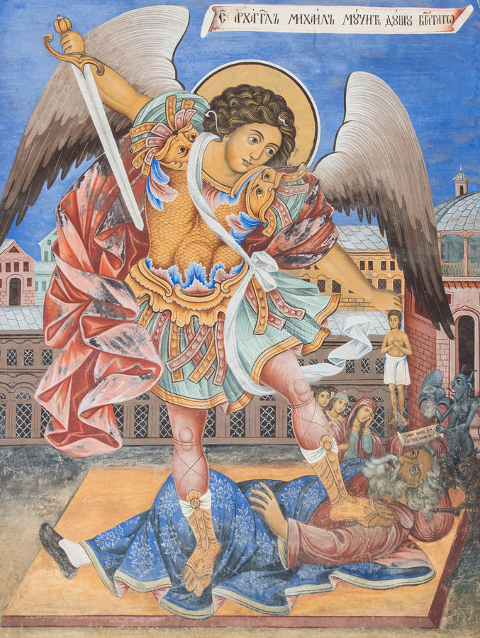 Archangel Michael Icon. An archangel Michael (Mihail / Mihael) church wall painting icon on one of the Rila Monastery walls. The archangel fights against evil stock images