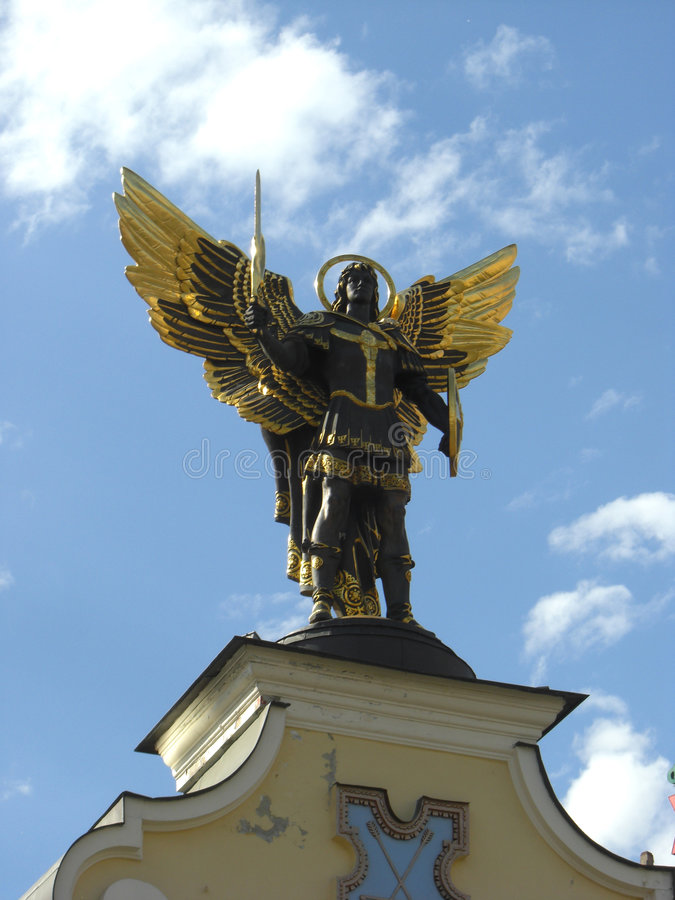 Archangel with sword and shield royalty free stock photography
