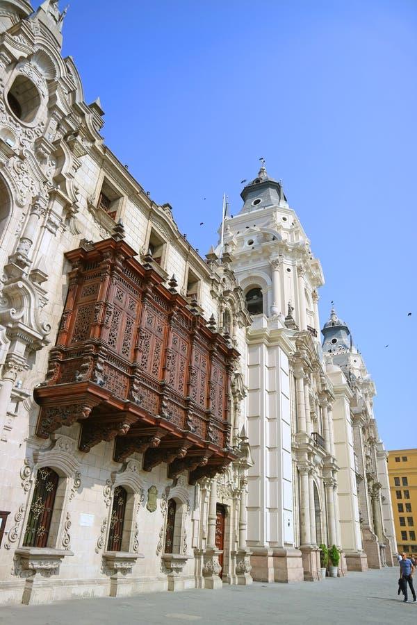 The Archbishop`s Palace of Lima with Lima Cathedral on Plaza Mayor, Lima, Peru royalty free stock image