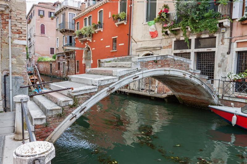 Arched Brick Bridge over Canal in Venice stock photography
