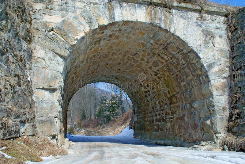 Arched bridge tunnel made of stone royalty free stock photography