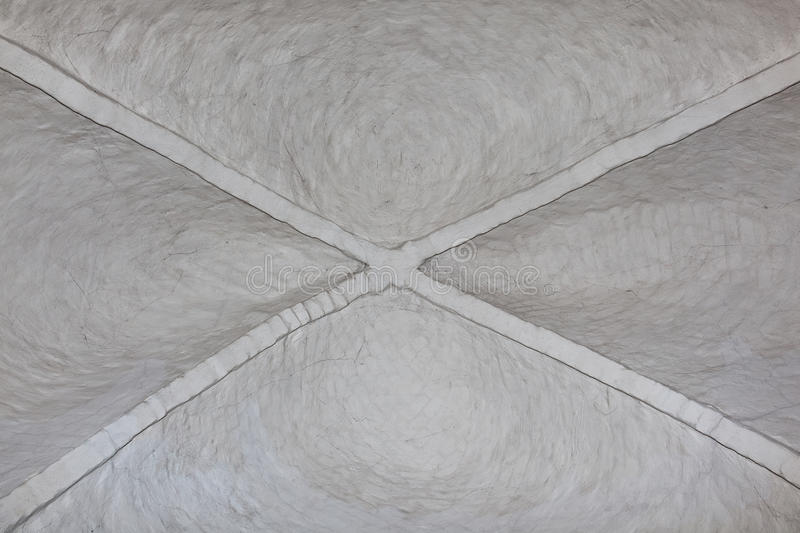 Arched ceiling. The white arched ceiling of a medieval stone church royalty free stock image