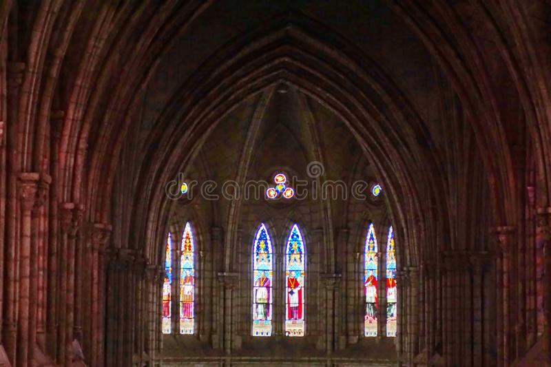 Arched ceiling and stained glass windows in a church royalty free stock images