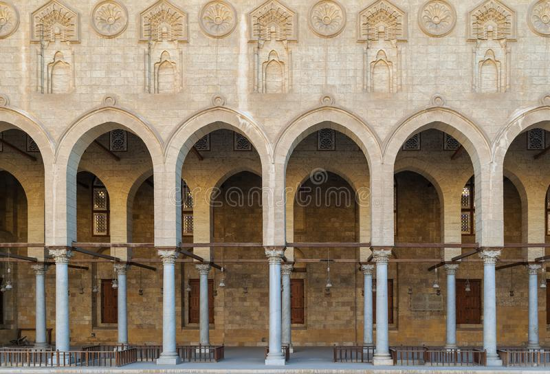 Arched corridor surrounding the courtyard of public historic Moaayad mosque, Cairo, Egypt. Arched corridor surrounding the courtyard of public ancient mosque of stock photos
