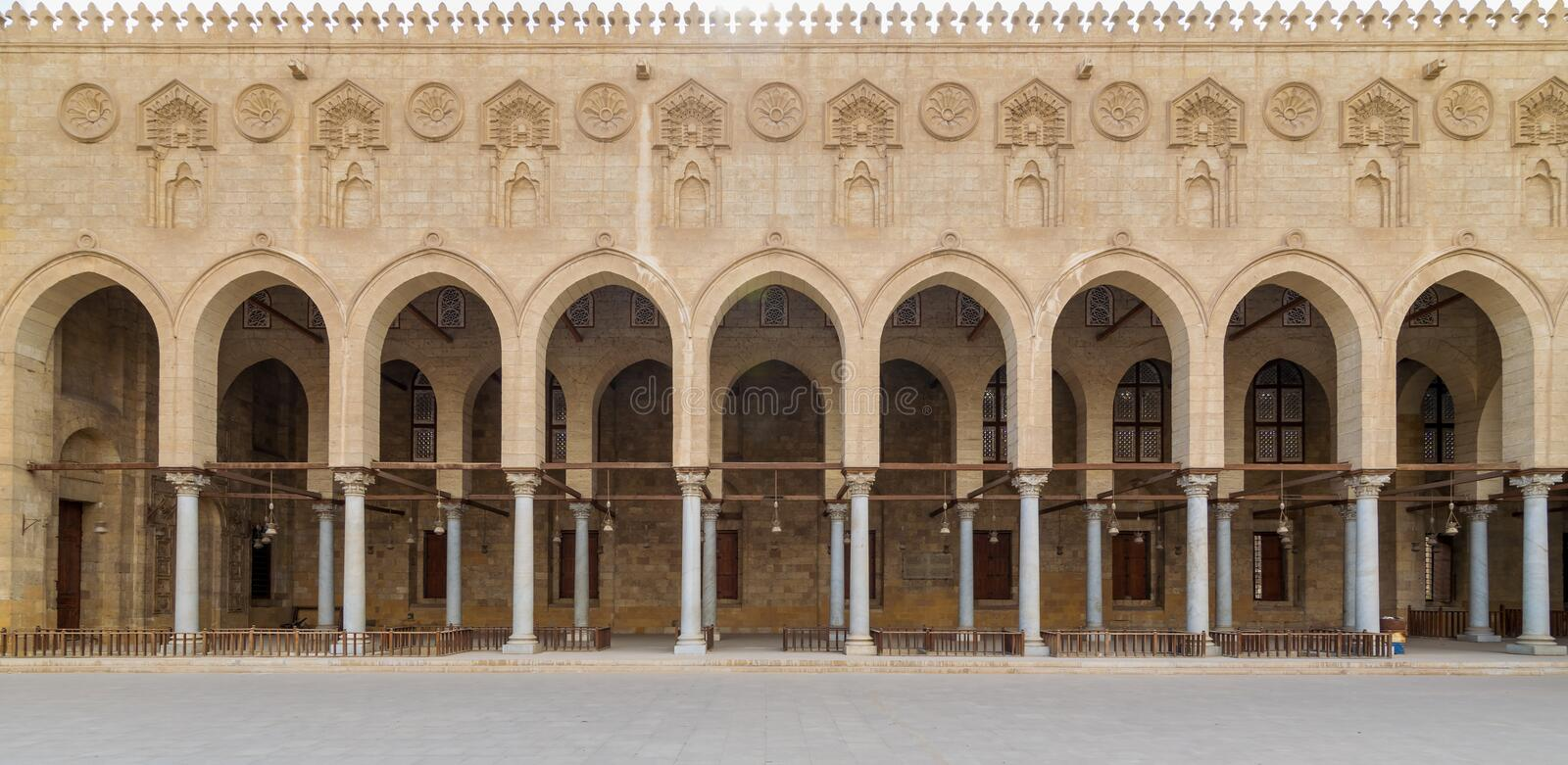 Arched corridor surrounding the courtyard of public historic Moaayad mosque, Cairo, Egypt. Arched corridor surrounding the courtyard of public ancient mosque of stock photography