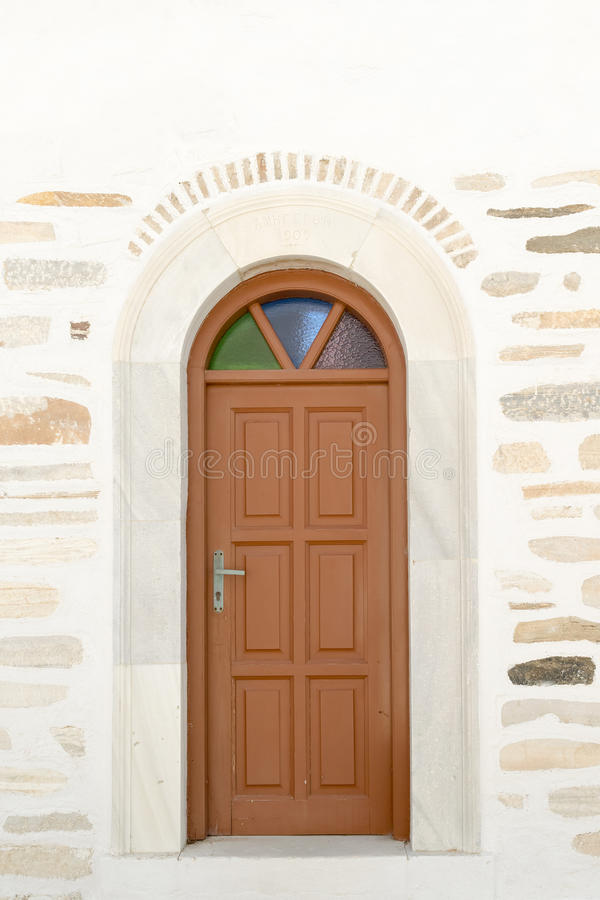 Arched doorway of the local church of Marpissa village at Paros island. royalty free stock image
