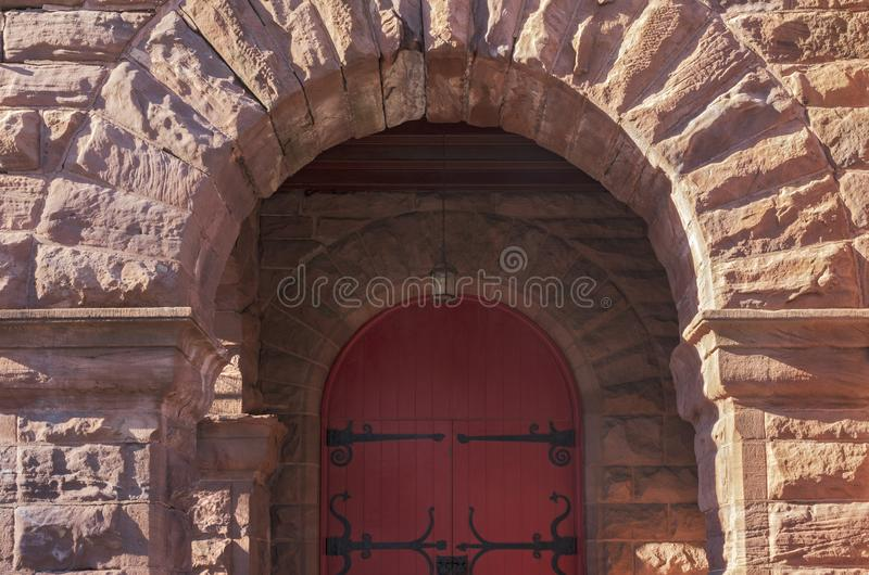 Arched Entrance and Door of Landmark Church. Entrance archway and door of landmark church of richardsonian romanesque style architecture stock image