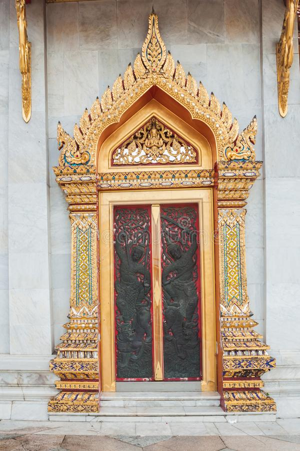 Arched entrance golden carving door royalty free stock photo