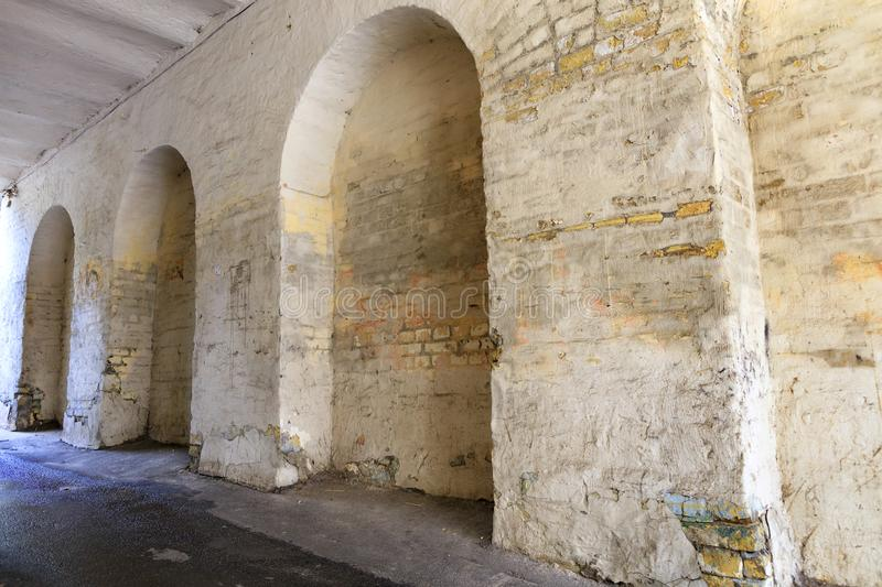 Arched niches in the old kirichnaya wall of the house. Covered with weathered paint and patched plaster stock photos