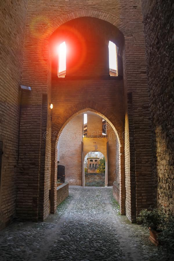 Arched passage in ancient fortress. Vignola, Italy royalty free stock image