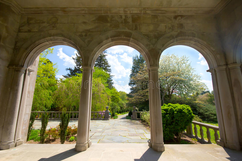 Arched Portico. View from arched portico looking out into the gardens at historic Long Island Gold Coast Mansion stock photography