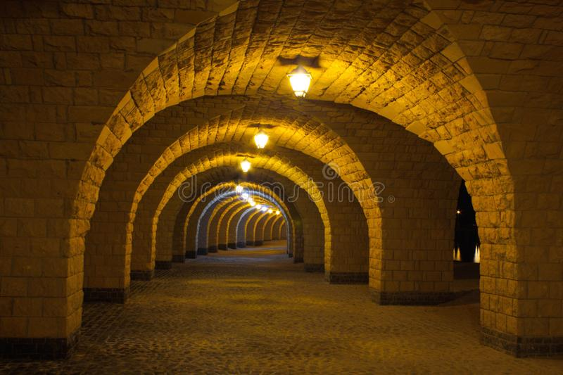 The arched stone colonnade with lanterns stock photography