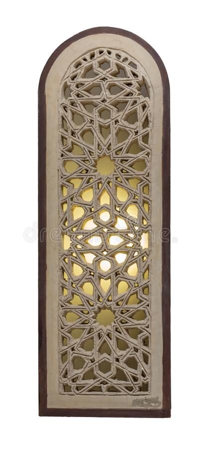 Arched stucco window decorated with illuminated stain glass with geometrical patterns, a Mamluk era tradition royalty free stock images