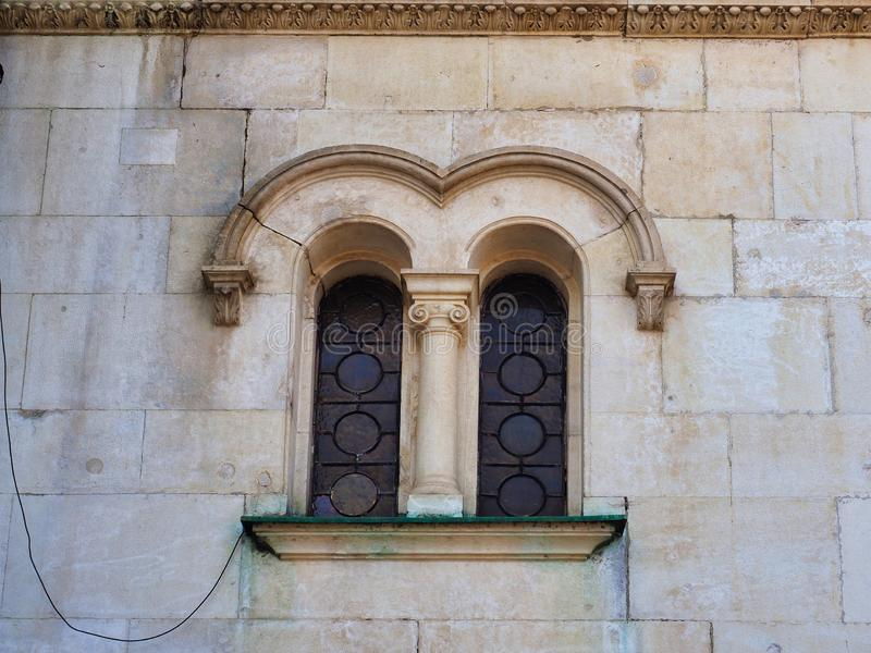 Arched Window Detail, Alexander Nevsky Cathedral, Sofia, Bulgaria. Arched stone detail over small windows on the stone block external wall of the Alexander royalty free stock photos