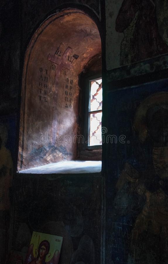 Arched window in the old church stock images