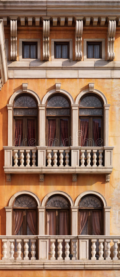 Arched windows of Venetian house stock images