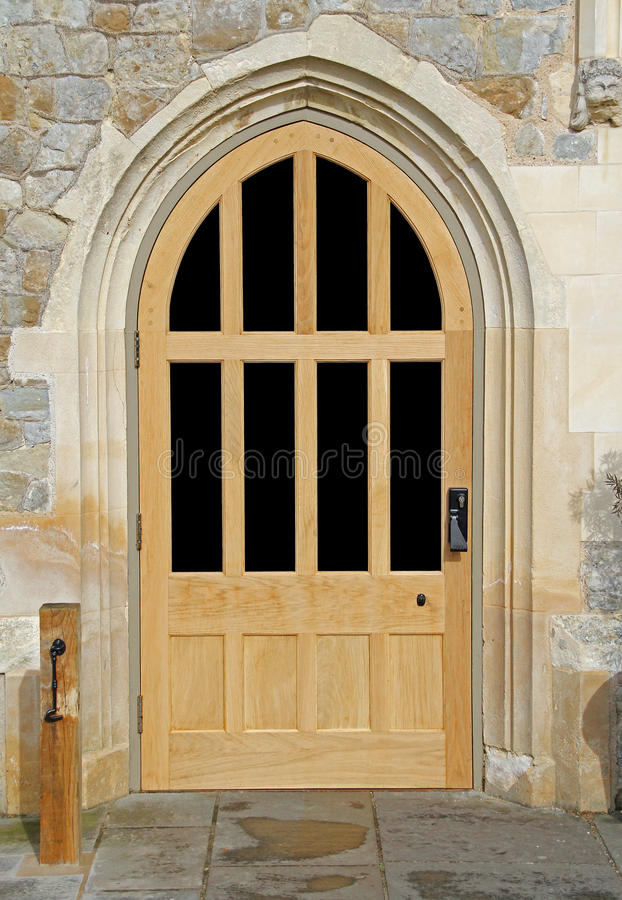 Arched wooden castle door stock image. Image of arch - 70669025