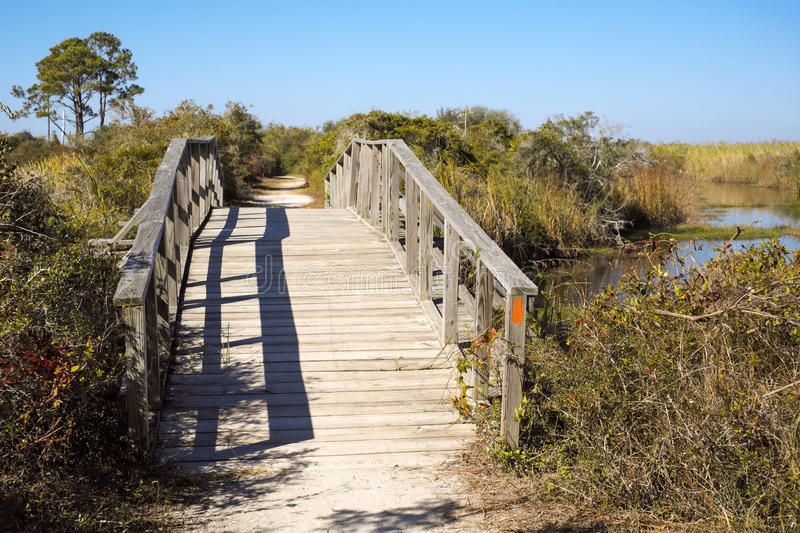 Arched Wooden Foot Bridge in Florida Wetland stock photos