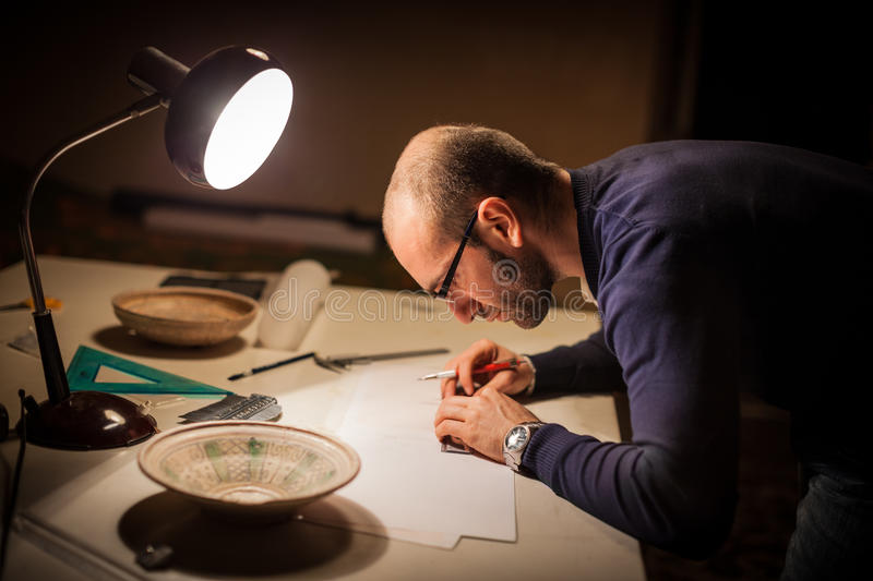 Archeologist with croks royalty free stock photography