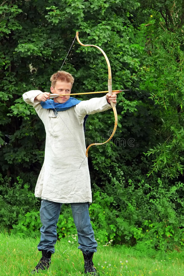 Archer aiming bow royalty free stock photography