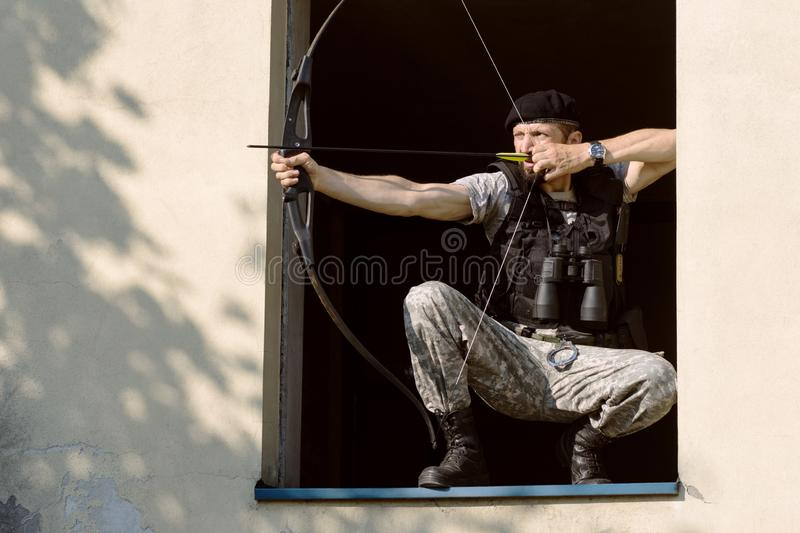 Archer aiming bow and arrow royalty free stock photo