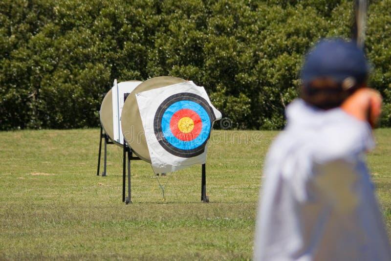 Archer ed obiettivo fotografia stock