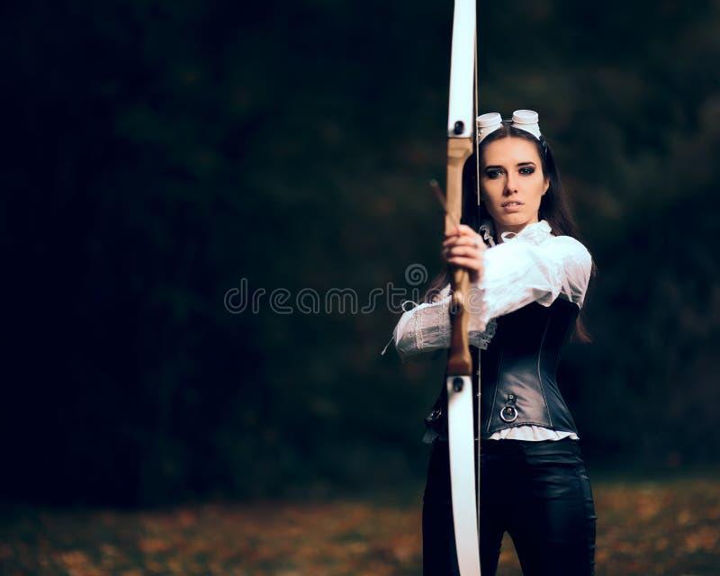 Archer femenino Warrior en traje con el arco y la flecha imagen de archivo libre de regalías