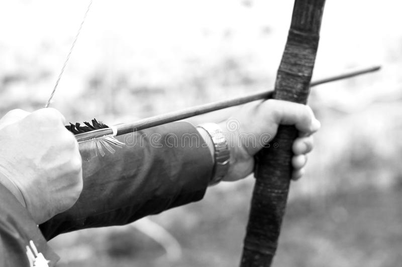 Archer holds his bow, black and white photo royalty free stock image