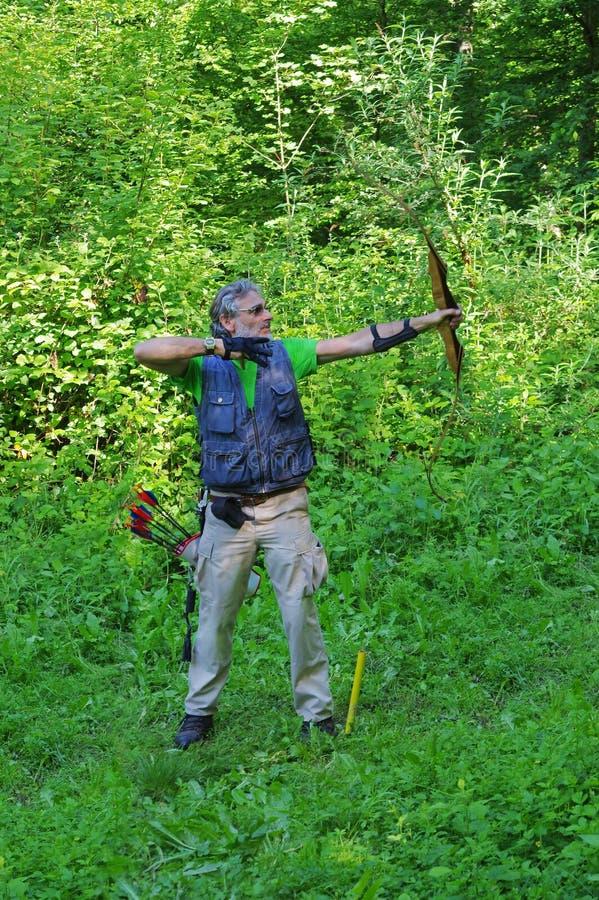 Archer nella foresta fotografie stock libere da diritti