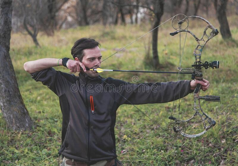 Archer shooting compound bow royalty free stock photos