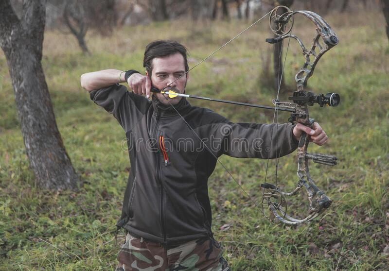 Archer shooting compound bow royalty free stock photo
