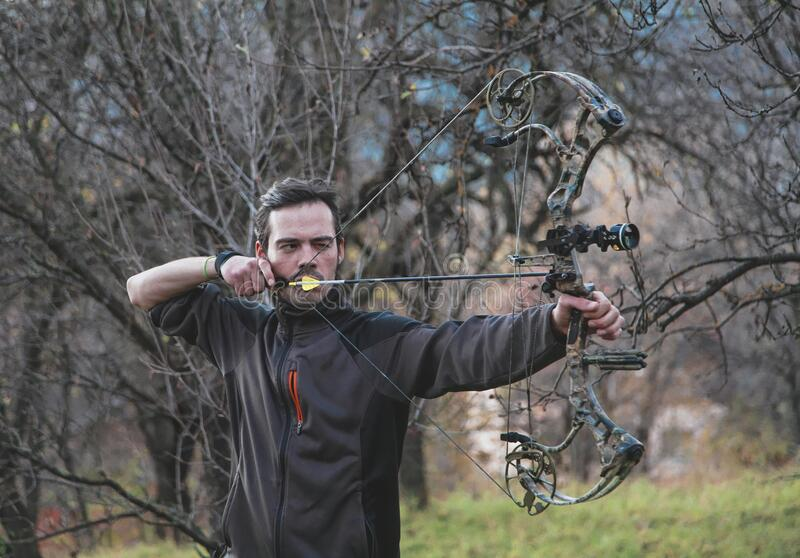 Archer shooting compound bow stock images
