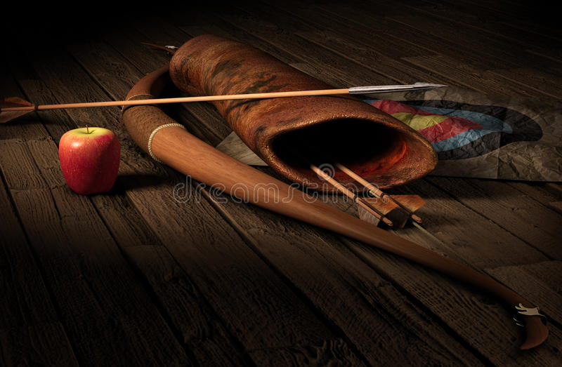 Archery. Vintage archery paraphernalia symbolizing targetging. Bow, arrows, quiverbag and a paper target on a rustic wood floor in dramatic lighting stock photo