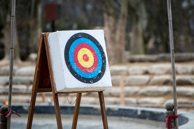 Archery with arrows and holes from previous hits.  royalty free stock images