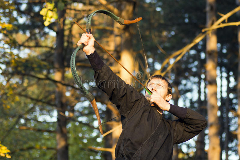 Archery in forest royalty free stock photo