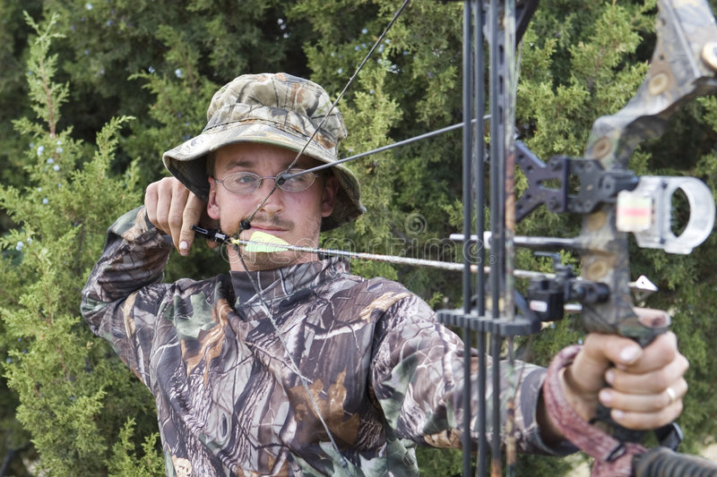 Archery hunter with bow stock images
