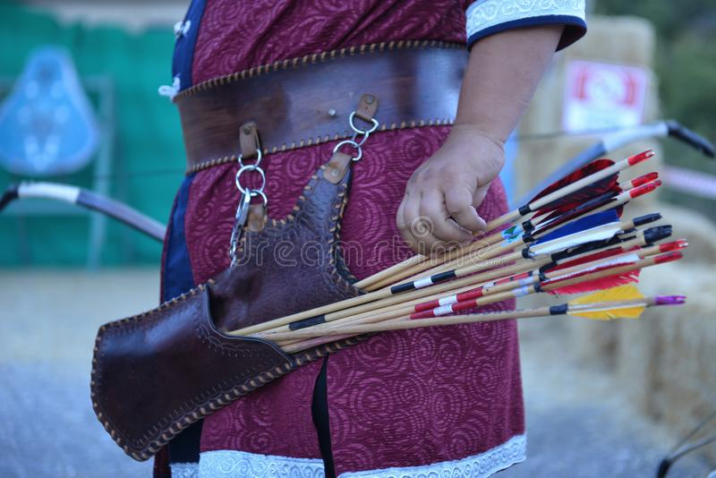 Archery trainings, shots and traditional local outfits. Professional archery work and arrow shooting preparation royalty free stock photography