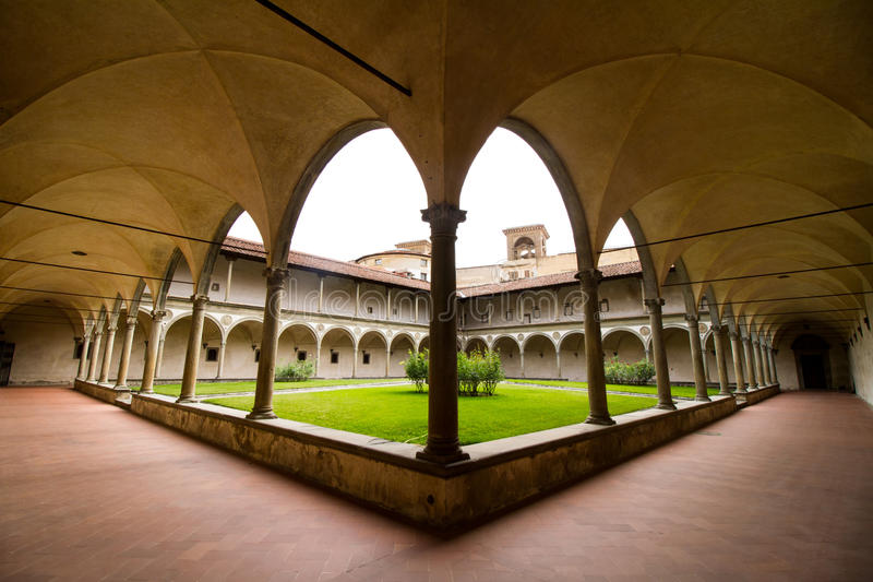 Arches. Arched causeway hallway breezeway courtyard brick marble gothic green grassy royalty free stock photography