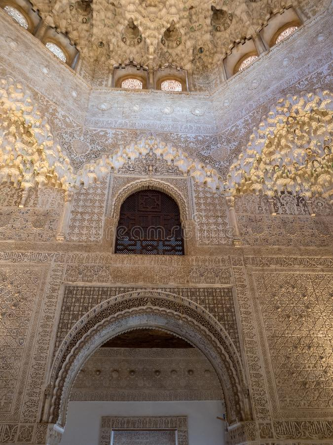 GRANADA, SPAIN - March 2018: Arches and columns of Alhambra. It is a palace and fortress complex located in Granada. royalty free stock photo