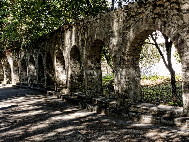 Arches in the Grounds of the Mon Repose Palace on the Greek Island of Corfu. Mon Repose Palace is where Philip the Duke of Edinburgh was born. Corfu which is a stock photography