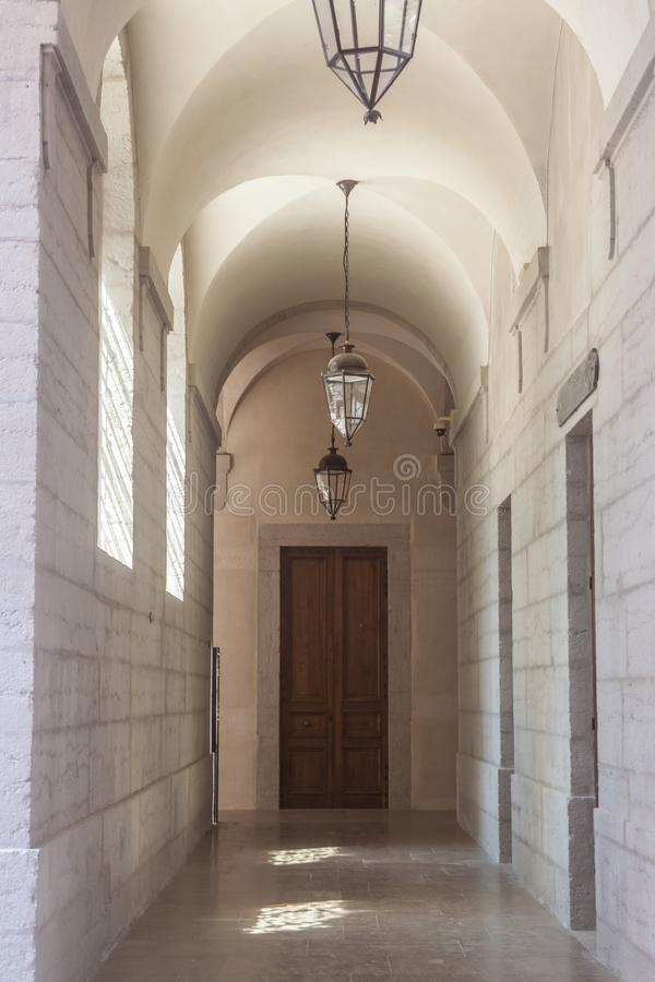 Arches and lobby of the cloister in a medieval monastery in Lyon, France, with its typical stone and marble architecture. Picture of the corridor of a old royalty free stock images