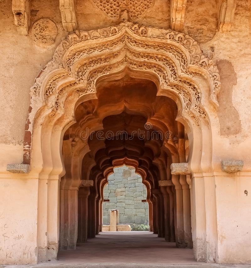 Arches of lotus temple in the ancient ruins of Hampi royalty free stock image