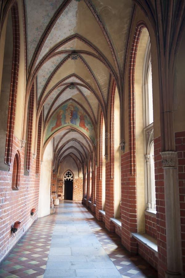 Arches in Malbork Castle, Poland. Arch corridor, arcade corridor.  royalty free stock images