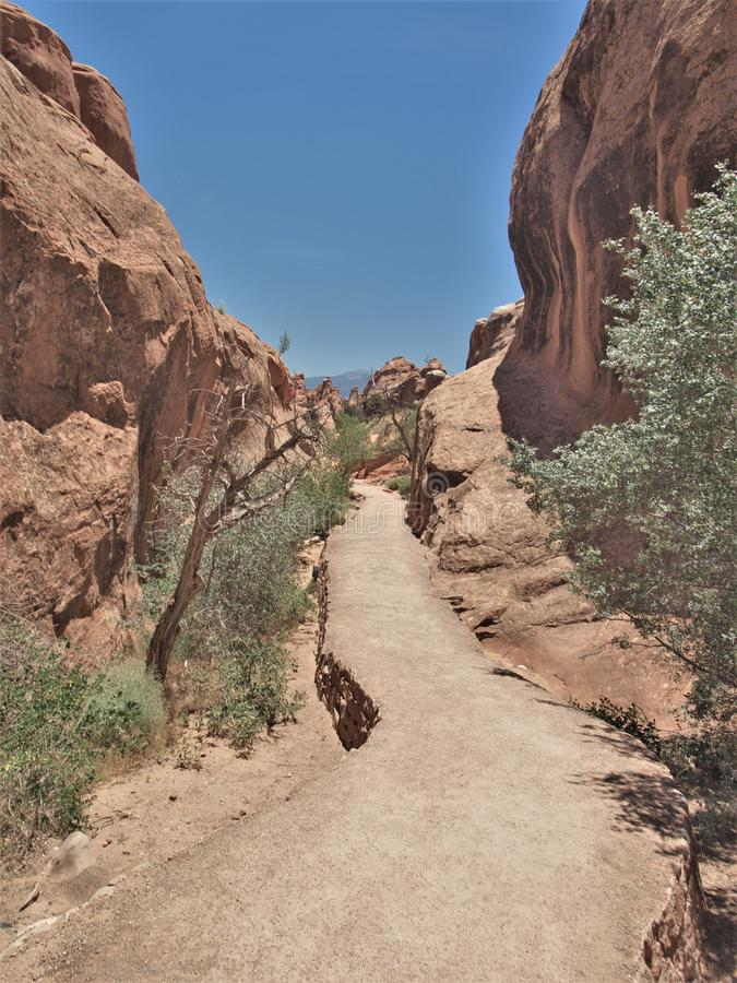 Hiking Trail at Arches National Park in Utah. Arches National Park near Moab, Utah is red rock country. It has over 2000 natural stone arches and numerous stock photos