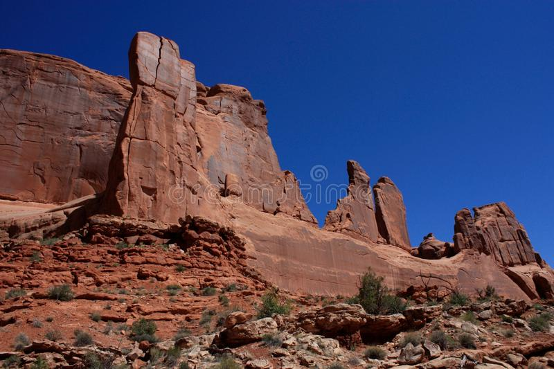 Monoliths of Park Avenue. Arches National Park in Utah offers spectacular views of mountains and rock formations.  The park has over 2,000 natural stone arches stock photo