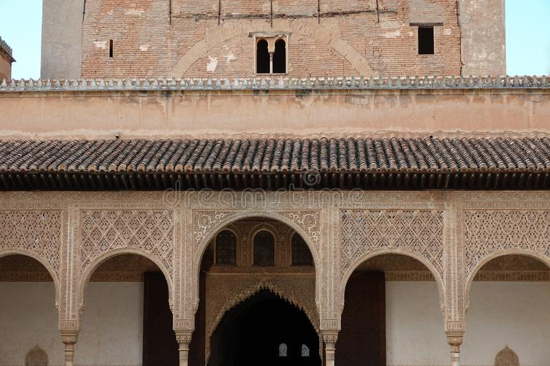 Arches of Palacio de Comares at Nasrid palace of the Alhambra in Granada, Andalusia. Wall decorations with arabesque ornaments at the Palacio De Comares at the royalty free stock images