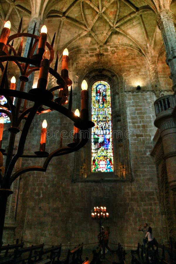 Arches stained glass windows and monumental columns of Santa Maria de Belem church royalty free stock photography