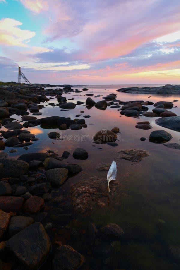Sunrise over rocky coastline stock photography