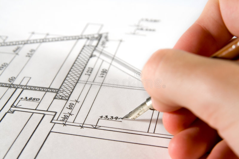 Architect with blueprint. Architect (developer, student) drawing his project of exterior stock images