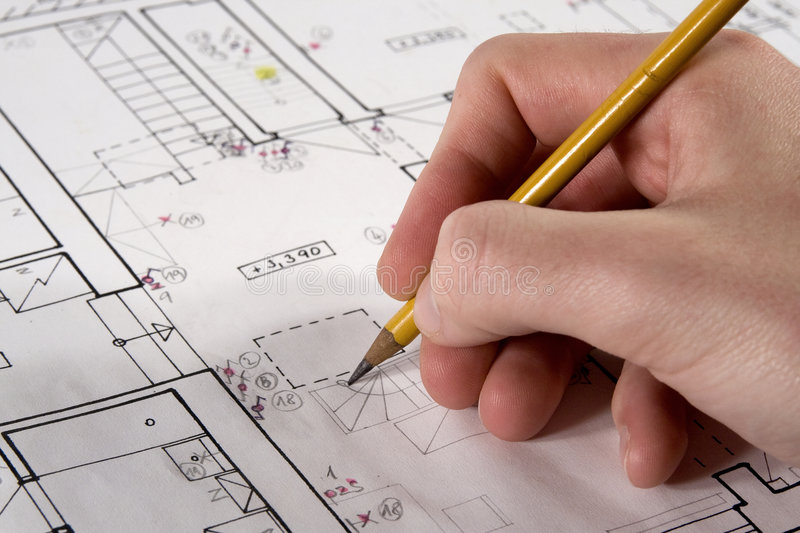 Architect with blueprint. Architect (developer, student) drawing his project of interior stock photo